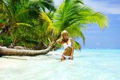 Woman under palm. Sea on backgroud Stock Photos