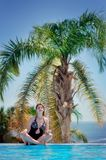 The woman under a palm tree Royalty Free Stock Photography