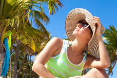 Woman under palm tree at beach Royalty Free Stock Photo
