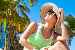 Woman under palm tree at beach Royalty Free Stock Photography