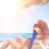 Woman under a palm tree Stock Image
