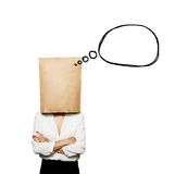 Woman under paper bag with speech balloon Royalty Free Stock Photos