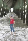 Woman under the pier Royalty Free Stock Image