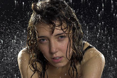 Woman under rain Stock Images