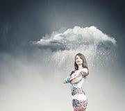 Woman under rain Stock Photo