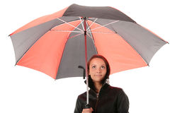 Woman under red and black umbrella Stock Image