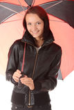 Woman under red and black umbrella Royalty Free Stock Image