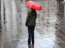 Woman under red umbrella Stock Photos