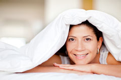 Woman under the sheets Royalty Free Stock Photography