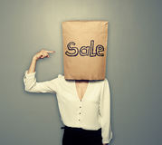 Woman under shopping bag Royalty Free Stock Images