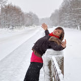 Woman under snow. Woman under the snow outdoors Royalty Free Stock Photos