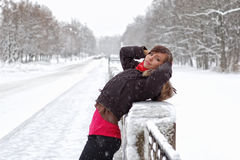 Woman under snow. On handrail stock photos
