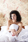 Woman under soft cover guess about day Royalty Free Stock Photos