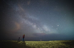 Woman under stars of Milky Way Galaxy Stock Images