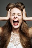 Woman is under stress Royalty Free Stock Photography