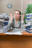 The woman under stress from excessive paper work. Woman under stress from excessive paper work Stock Images