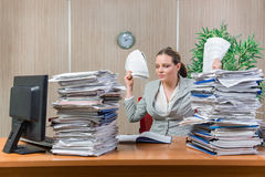 The woman under stress from excessive paper work. Woman under stress from excessive paper work Royalty Free Stock Images