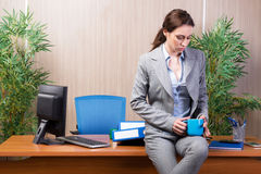 The woman under stress working in the office Royalty Free Stock Image