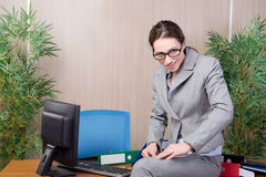The woman under stress working in the office Stock Photos