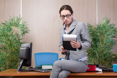 The woman under stress working in the office Stock Images
