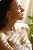 Woman under sun Stock Photos