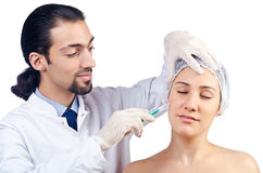 Woman under the   surgery Royalty Free Stock Photos