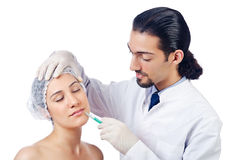 Woman under the surgery Stock Image