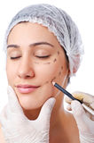 Woman under the   surgery Stock Photography