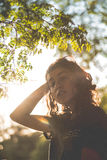 Woman under tree Royalty Free Stock Photo
