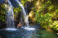 Woman Under Tropical Waterfall Royalty Free Stock Photography
