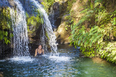 Woman Under A Tropical Waterfall Royalty Free Stock Images