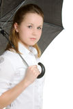 A woman under an umbrella Stock Image
