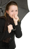 A woman under an umbrella Stock Photos