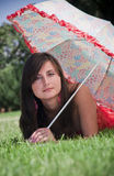 Woman under umbrella. Attractive woman under umbrella on grass Stock Images
