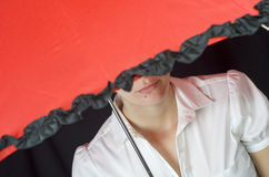 Woman under umbrella. Mysterious woman under umbrella on black Stock Photo