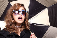 Woman under an umbrella Stock Photo