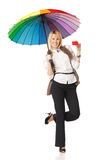 Woman under umbrella holding blank credit card Royalty Free Stock Photography