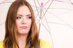 Woman under umbrella looking sad unhappy Royalty Free Stock Photos