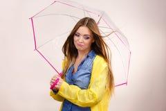 Woman under umbrella looking sad unhappy Royalty Free Stock Photo