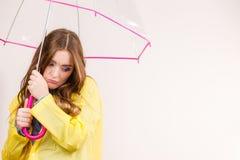 Woman under umbrella looking sad unhappy Stock Photos
