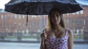 Woman under umbrella in the rain Stock Photos