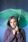 Woman under an umbrella Stock Photo