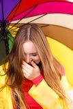Woman under umbrella sneezing Royalty Free Stock Images