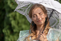 Woman under an umbrella from the sun Royalty Free Stock Photo
