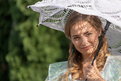 Woman under an umbrella from the sun Royalty Free Stock Photography