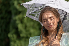 Woman under an umbrella from the sun Stock Photo