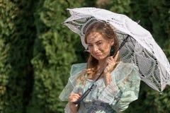 Woman under an umbrella from the sun Stock Photos