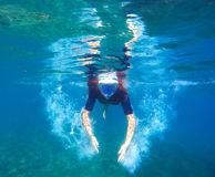 Woman under water makes bubbles, snorkel woman snorkeling in black mask Royalty Free Stock Images