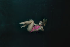 Woman under water. Stock Photo