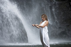 Woman Under Waterfall Stock Image